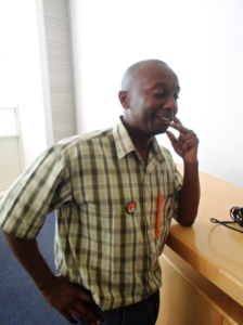 Nyathi showing off his badge and pen