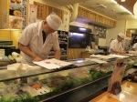 The itamae preparing sushi.